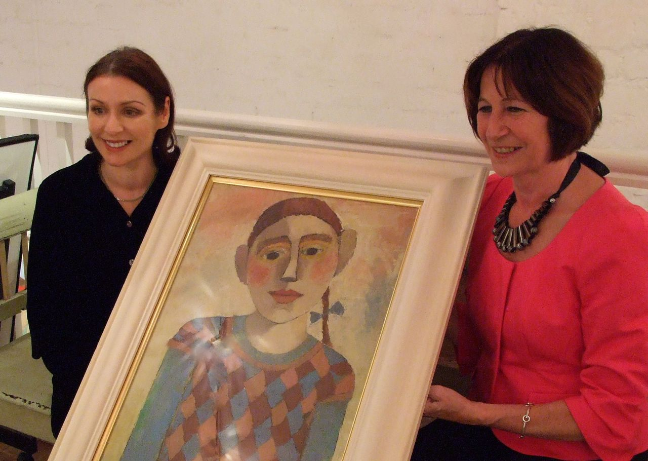 Lady Fiona Fraser accepting the donation of Catriona Millar's painting Cherubino on behalf of the Ninewells Cancer Campaign